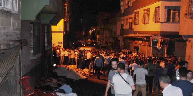 People gather after an explosion in Gaziantep, southeastern Turkey, early Sunday, Aug. 21, 2016. Gaziantep Province Gov. Ali Yerlikaya said the deadly blast, during a wedding near the border with Syria, was a terror attack.