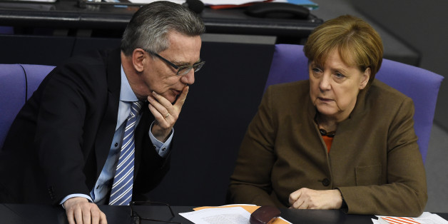German Chancellor Angela Merkel (R) chats with German Interior Minister Thomas de Maiziere during a session of the Bundestag lower house of parliament in Berlin November 27, 2015. AFP PHOTO / TOBIAS SCHWARZ / AFP / TOBIAS SCHWARZ        (Photo credit should read TOBIAS SCHWARZ/AFP/Getty Images)