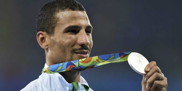 2016 Rio Olympics - Athletics - Victory Ceremony - Men's 1500m Victory Ceremony - Olympic Stadium - Rio de Janeiro, Brazil - 20/08/2016. Taoufik Makhloufi (ALG) of Algeria poses with his silver medal. REUTERS/Dylan Martinez  FOR EDITORIAL USE ONLY. NOT FOR SALE FOR MARKETING OR ADVERTISING CAMPAIGNS.