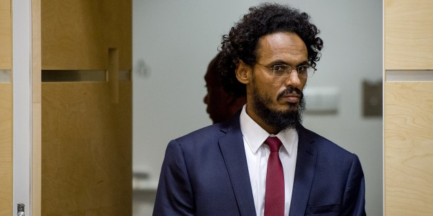 Alleged Al-Qaeda-linked Islamist leader Ahmad Faqi Al Mahdi arrives in the courtroom of the International Criminal Court (ICC) on September 30, 2015, in The Hague. Ahmad Al Faqi Al Mahdi was transferred to the ICC on September 26 following an arrest warrant issued by the Court on September 18 facing charges of ordering the destruction of monuments in Mali's fabled city of Timbuktu. AFP PHOTO / ANP POOL / ROBIN VAN LONKHUIJSEM   ==NETHERLANDS OUT==        (Photo credit should read ROBIN VAN LONKH
