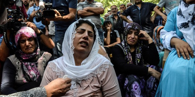 TOPSHOT - Women cry during a funeral  for a victim of last night's attack on a wedding party that left 50 dead in Gaziantep in southeastern Turkey near the Syrian border on August 21, 2016.  At least 50 people were killed when a suspected suicide bomber linked to Islamic State jihadists attacked a wedding thronged with guests, officials said on August 21. Turkish President Recep Tayyip Erdogan said the IS extremist group was the 'likely perpetrator' of the bomb attack, the deadliest in 2016, in Gaziantep late Saturday that targeted a celebration attended by many Kurds.  / AFP / ILYAS AKENGIN        (Photo credit should read ILYAS AKENGIN/AFP/Getty Images)