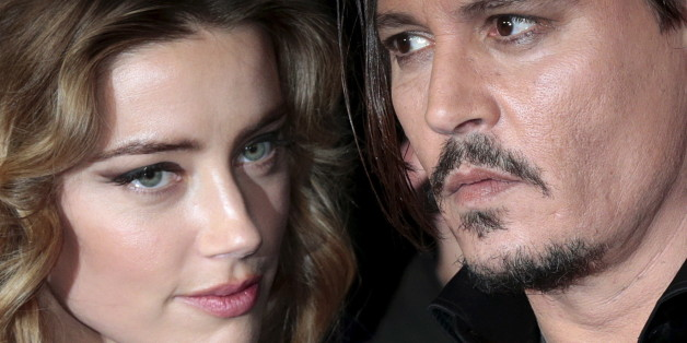 "Cast member Johnny Depp and his actress wife Amber Heard arrive for the British premiere of the film ""Black Mass"" in London, Britain October 11, 2015. REUTERS/Suzanne Plunkett"