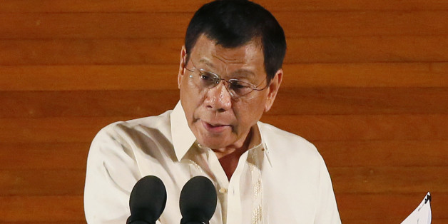 FILE - In this Monday,  July 25, 2016 file photo, Philippine President Rodrigo Duterte delivers his first State of the Nation Address before the joint session of the 17th Congress in suburban Quezon city, northeast of Manila, Philippines. Duterte on Thursday, July 28, threatened to withdraw a ceasefire order he gave three days ago after suspected communist rebels killed a government militiaman and wounded four others in an attack. (AP Photo/Bullit Marquez, File)