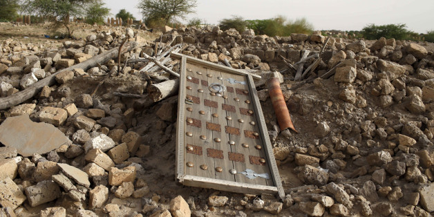 The rubble left from an ancient mausoleum destroyed by Islamist militants, is seen in Timbuktu, Mali, July 25, 2013. REUTERS/Joe Penney/File Photo
