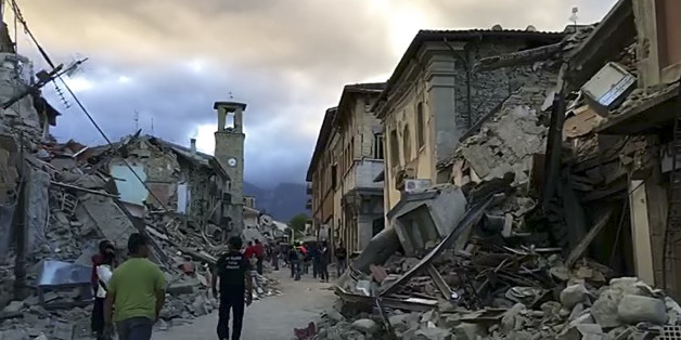 This still image taken from video shows the center of Amatrice, central Italy, where a 6.1 earthquake struck just after 3:30 a.m., Wednesday, Aug. 24, 2016. The quake was felt across a broad section of central Italy, including the capital Rome where people in homes in the historic center felt a long swaying followed by aftershocks. (AP Photo)