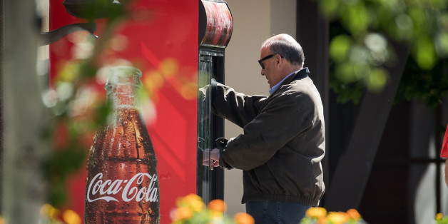 SUN VALLEY, ID - JULY 6: Ahmet Muhtar Kent, chief executive officer of The Coca-Cola Company, gets a soda out of Coke branded refrigerator as he attends the annual Allen & Company Sun Valley Conference, July 6, 2016 in Sun Valley, Idaho. Every July, some of the world's most wealthy and powerful businesspeople from the media, finance, technology and political spheres converge at the Sun Valley Resort for the exclusive weeklong conference. (Photo by Drew Angerer/Getty Images)
