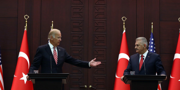 U.S Vice President Joe Biden, left, speaks to the media after talks with Turkish Prime Minister Binali Yildirim in Ankara, Turkey, Wednesday, Aug. 24, 2016. Biden called on Turkish authorities on Wednesday to be patient with the U.S. legal system as Turkey seeks the return of a cleric accused of masterminding last month's failed military coup. Biden, who met with Turkish officials in Ankara, said that the extradition process would take time as he reaffirmed Washington's cooperation in the case of U.S.-based Muslim cleric Fethullah Gulen.(AP Photo/Burhan Ozbilici)