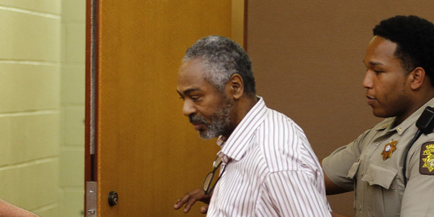 Martin Blackwell is led out of a courtroom after being found guilty during his trial in Atlanta, Wednesday, Aug. 24, 2016. Blackwell was convicted of pouring hot water on two gay men as they slept and sentenced to 40 years in prison. (AP Photo/John Bazemore)