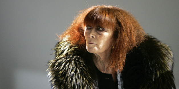 FILE - In this Jan.18 2008 file photo, French fashion designer Sonia Rykiel looks on prior to the presentation of her men's fall/winter 2008-2009 fashion collection presented in Paris. Rykiel, whose relaxed striped sweaters helped liberate women from their stuffy suits and who went on to run a global fashion empire, has died at 86, according to the French president's office. (AP Photo/Thibault Camus, File)