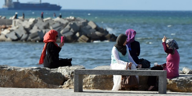 TO GO WITH AFP STORY BY ABDELLAH CHEBALLAHAlgerian women sit on the Sablettes seafront promenade on May 31, 2014 in the capital Algiers. Algerian authorities plan to redevelop the Bay of Algiers by 2030 with numerous renovation and expansion projects. AFP PHOTO/FAROUK BATICHE        (Photo credit should read FAROUK BATICHE/AFP/Getty Images)