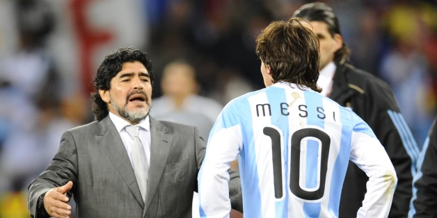 Argentina's coach Diego Maradona (L) looks dejected in front of Argentina's striker Lionel Messi after they lost the 2010 World Cup quarter-final football match Argentina vs. Germany on July 3, 2010 at Green Point stadium in Cape Town. Germany qualified for the semi-finals.  NO PUSH TO MOBILE / MOBILE USE SOLELY WITHIN EDITORIAL ARTICLE -    AFP PHOTO / DANIEL GARCIA (Photo credit should read DANIEL GARCIA/AFP/Getty Images)