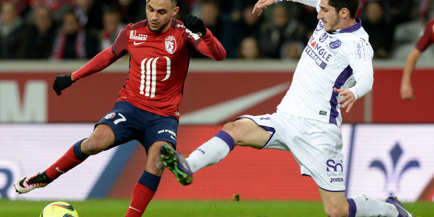 Lille's French midfielder Sofiane Boufal (L) challenges Toulouse's French  midfielder Yann Bodiger during the French L1 football match between Lille and Toulouse at the Grand Stade Pierre Mauroy Stadium in Villeneuve d'Ascq on March 19, 2016. AFP PHOTO / DENIS CHARLET / AFP / DENIS CHARLET        (Photo credit should read DENIS CHARLET/AFP/Getty Images)