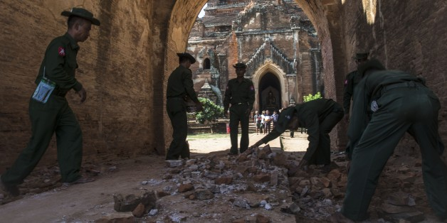 BAGAN, MYANMAR - AUGUST 25 : Myanmar military staff and a police officer collect the pieces of bricks of Dhammayangyi temple after earthquake in ancient Bagan city, Myanmar on August 25, 2016. The magnitude 6.8 earthquake that rocked central Myanmar has left at least four people dead and more than 200 ancient temples and pagodas damaged, government officials said Thursday. (Photo by Kyaw Kyaw/Anadolu Agency/Getty Images)