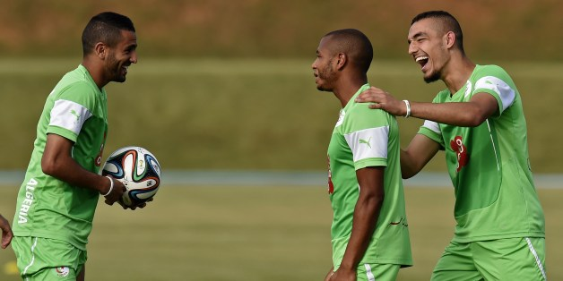 Algeria's midfielder Nabil Bentaleb (R), midfielder Yacine Brahimi (C) and forward Riyad Mahrez (L) joke during a training session at the Atletico World Sports Center in Sorocaba, Brazil on June 14, 2014, during the 2014 FIFA World Cup. AFP PHOTO / PHILIPPE DESMAZES        (Photo credit should read PHILIPPE DESMAZES/AFP/Getty Images)
