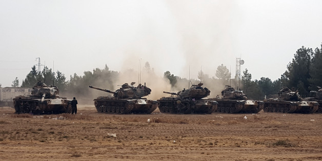 Turkish army tanks stationed near the Syrian border, in Karkamis, Turkey, Thursday, Aug. 25, 2016. Turkish President Recep Tayyip Erdogan late Wednesday said that Syrian opposition forces aided by Ankara have taken back the border town of Jarablus from the Islamic State group. (AP Photo)