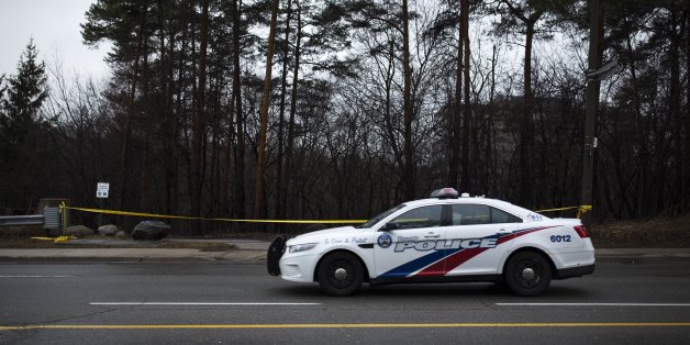 TORONTO, ON - March 14 - A police car drives past police tape around the park near Don River Trail at Sheppard Avenue and Leslie Street, where the fatal police shooting of 21-year-old man occurred.        (Melissa Renwick/Toronto Star via Getty Images)