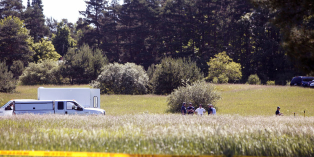 OAKLAND TOWNSHIP, MI - JUNE 17:  FBI agents search a field outside Detroit for the alleged remains of former Teamsters' union president Jimmy Hoffa June 17, 2013 in Oakland Township, Michigan. The agents were acting on a tip provided by Tony Zerilli, 85, a former mobster, who was released from prison in 2008. Hoffa, who had reported ties to organized crime, went missing in July of 1975. (Photo by Bill Pugliano/Getty Images)
