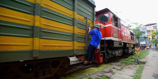 A train being shunted in the railway yard of Hanoi station.