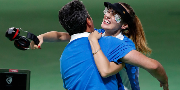 Anna Korakaki (R) of Greece hugs with her coach, also her father after the women's 25m pistol final of shooting at the 2016 Rio Olympic Games in Rio de Janeiro, Brazil, on Aug. 9, 2016. Anna Korakaki won the gold medal./ CHINA OUT