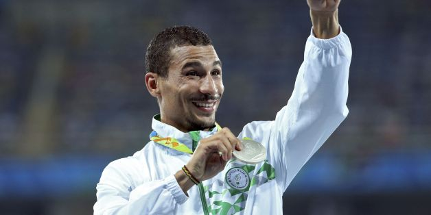 2016 Rio Olympics - Athletics - Victory Ceremony - Men's 1500m Victory Ceremony - Olympic Stadium - Rio de Janeiro, Brazil - 20/08/2016. Taoufik Makhloufi (ALG) of Algeria poses with his silver medal.   REUTERS/Stoyan Nenov  FOR EDITORIAL USE ONLY. NOT FOR SALE FOR MARKETING OR ADVERTISING CAMPAIGNS.