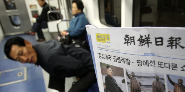 "A subway passenger reads a South Korean newspaper Chosun Ilbo reporting North Korea's rocket launch in Seoul, South Korea, Saturday, April 14, 2012.  North Korea's much-touted satellite launch ended in a nearly $1 billion failure, bringing humiliation to the country's new young leader and condemnation from a host of nations. The United Nations Security Council deplored the launch but stopped short of imposing new penalties in response. The headline reads "" Mid-air explosion of a strong nation an"