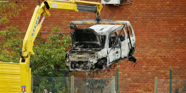This picture taken on August 29, 2016, shows the burnt car used to ram raid the National Institute for Criminalistics and Criminology (INCC-NICC) overnight in Neder-Over-Heembeek. An explosion 'of criminal origin' at Belgium's national criminology institute in Brussels early on August 29, 2016, caused a fire and major damage but no casualties, officials said. Belgian media said the blast was caused by a car which rammed the building. It comes as Belgium remains on high alert following the devast