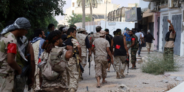 Members of the forces loyal to Libya's UN-backed Government of National Accord (GNA) walk toward their position in the coastal city of Sirte, east of the capital Tripoli, prior to their military operation to clear the Islamic State group's (IS) jihadists from the city on August 28, 2016.GNA forces who for more than three months have been pressing an offensive to retake Sirte from IS, pushed into the last areas of the city held by the group in what was the jihadists' coastal stronghold. / AFP / M