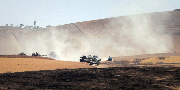 Turkish military move inside Syria near the Turkish border town of Karkamis, Turkey, Friday, Aug. 26, 2016. Turkey's state-run Anadolu news agency said late Thursday Turkish artillery have shelled a group of Syrian Kurdish militia fighters in he north of the town of Mambij after they allegedly ignored warnings to retreat. (Ismail Coskun, IHA via AP)