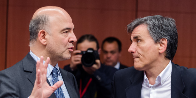 EU Commissioner for Economic and Financial Affairs, Taxation and Customs Pierre Moscovici, left, talks with Greece's Finance Minister Euclid Tsakalotos ahead of an EU eurogroup meeting at the EU Council building in Brussels on Monday May 9, 2016. European finance ministers gathered in Brussels Monday for talks aimed at breaking the deadlock over whether to provide more aid to bolster Greece's shattered economy and forgive some of its debts. (AP Photo/Geert Vanden Wijngaert)