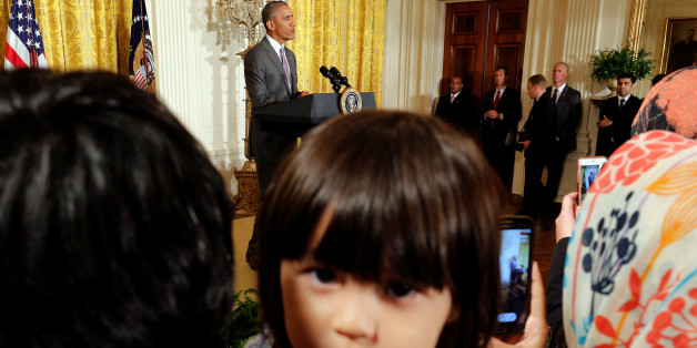 Sophia Ahmadinejad, 2-year-old, a refugee from Afghanistan listens as U.S. President Barack Obama delivers remarks at an Eid al-Fitr reception at the White House in Washington, U.S., July 21, 2016.   REUTERS/Carlos Barria