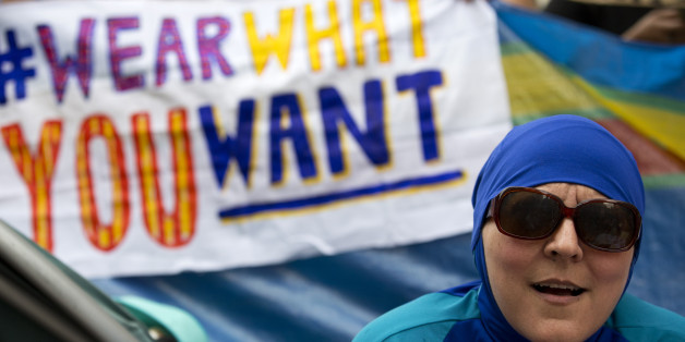 A woman wearing a 'Burkini' joins a protest outside the French Embassy in London on August 25, 2016, during a 'Wear what you want beach party' to demonstrate against the ban on Burkinis on French beaches and to show solidarity with Muslim women.French Interior Minister Bernard Cazeneuve warned Wednesday against stigmatising Muslims, as a furore over the banning of burkinis grew with the emergence of pictures showing police surrounding a veiled woman on a beach.  Dozens of French towns and villag