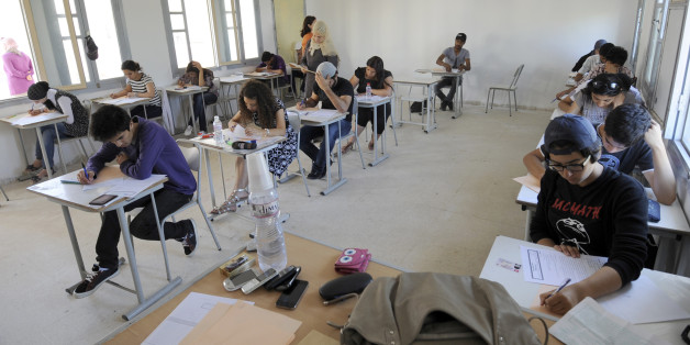 Tunisian students take the baccalaureat (high school graduation exam) exam on June 6, 2012 in Tunis. Some 129 181 candidates registered for the main session of the baccalaureat held this year from June 6 to 13. The average female candidates stood at 57.06% against 42% for boys. The Bachelor 2012 will be marked by the application of an adult aged 64 years and five students who are serving a prison sentence. The exam results will be announced on June 23, 2012. AFP PHOTO / FETHI BELAID        (Photo credit should read FETHI BELAID/AFP/GettyImages)