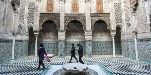 Tourists visit Al-Attarine Madrasa, an historic religious school and mosque in Fez, Morocco, Sunday, Feb. 7, 2016. The madrasa takes its name from the Souk al-Attarine, the spice and perfume market. (AP Photo/Mosa'ab Elshamy)