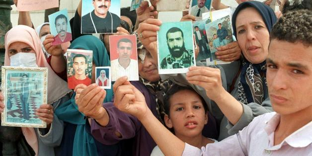 ALGIERS, ALGERIA:  Families of missing victims of terrorism in Algeria hold a weekly demonstration at the National Office of Human Rights 02 September at Addis Ababa Square, showing photos of their relatives who have disappeared in the continuing Algerian civil war. (Photo credit should read STR/AFP/Getty Images)