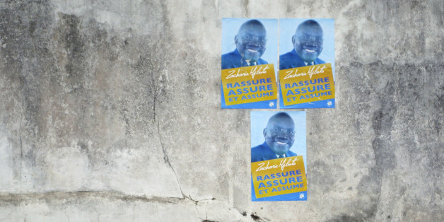 A man walks past election posters for Zacharie Myboto, one of the 23 declared presidential candidates for Sunday's poll, in the capital Libreville, August 22, 2009. The winner of Gabon's August 30 presidential election will have to tackle a stretched budget and an oil economy in long-term decline, but international partners are unlikely to see a shift from investor-friendly policies. None of the candidates standing to succeed Omar Bongo, who towered over the central west African state for four d
