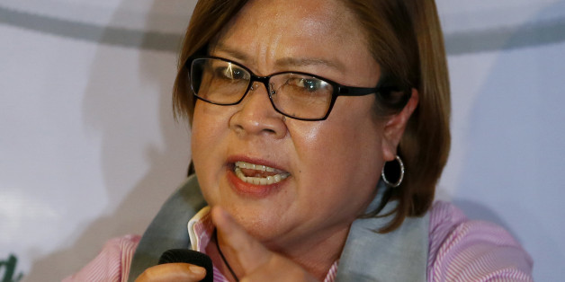 "Former Justice Secretary and now Senator Leila De Lima gestures during a news conference she called to answer allegations about her alleged links to illegal drugs Saturday, Aug. 20, 2016 in suburban Quezon city northeast of Manila, Philippines. De Lima, who was called ""immoral"" by President Rodrigo Duterte, said she is ""willing to be shot in front of the President"" if there is evidence she is involved in illegal drugs. De Lima is scheduled to open a Senate investigation on Monday on the extra-ju"