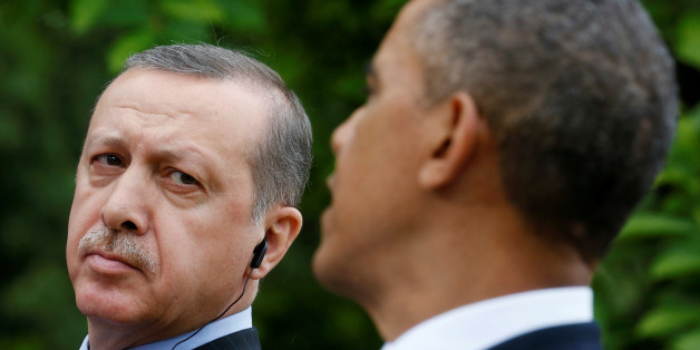 FILE PHOTO -  Turkish Prime Minister Recep Tayyip Erdogan (L) listens as U.S. President Barack Obama (R) addresses a joint news conference in the White House Rose Garden in Washington, May 16, 2013.   REUTERS/Kevin Lamarque/File Photo