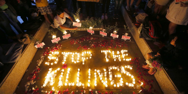 "Human rights activists light candles for the victims of extra-judicial killings around the country in the wake of ""War on Drugs"" campaign by Philippine President Rodrigo Duterte Monday, Aug. 15, 2016 in suburban Quezon city, northeast of Manila, Philippines. The ""war on drugs"" campaign, which saw hundreds of mostly poor victims, has been condemned by human rights groups including the United Nations Chief Ban Ki-moon. (AP Photo/Bullit Marquez)"