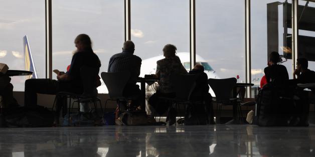 People in airport waiting area, Frankfurt, Germany