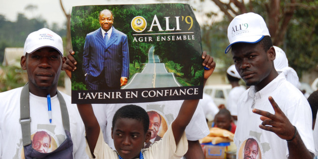 "Supporters of Ali Bongo Ondimba, son of former dictator Omar Bongo, attend a campaign rally in Ntoum, outside Libreville, Gabon Sunday Aug. 23, 2009. The younger Bongo, 50, is running to replace his father, who ruled the central African nation for 41 years until his death in June, in presidential elections Sunday, Aug. 30. Poster reads: Top: ""To Act Together"" and bottom, ""The Future in Confidence"". (AP Photo/Joel Bouopda Tatou)"