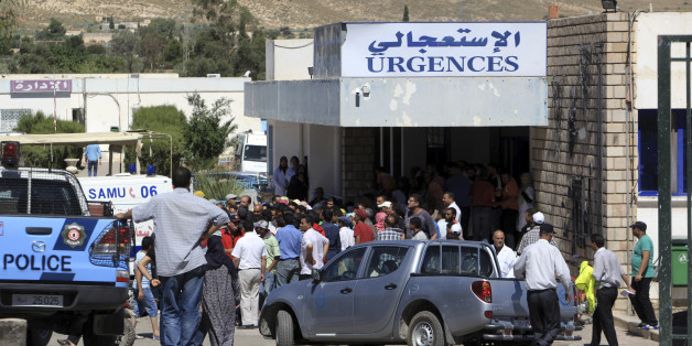 Residents gather outside the hospital of Kasserine, near the Algerian border, Thursday, July 17, 2014. Militants in western Tunisia staged two simultaneous attacks on army posts while soldiers held a Ramadan feast, killing at least 14 soldiers, authorities said Thursday. (AP Photo/ Mouldi Kraeim)