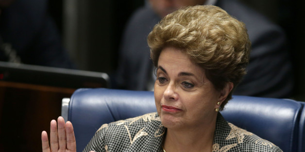 Suspended Brazilian President Dilma Rousseff waves goodbye after her impeachment trial at the Federal Senate in Brasilia, Brazil, Monday, Aug. 29, 2016. Rousseff's scheduled appearance during her impeachment trial is the culmination of a fight going back to late last year, when opponents in Congress presented a measure seeking to remove her from office. Her accusers say she hurt the economy with budget manipulations; she argues she did nothing wrong and is being targeted by corrupt lawmakers. (AP Photo/Eraldo Peres)