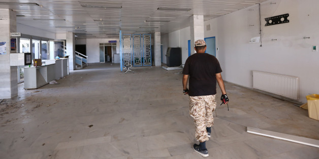 A picture shows on August 15, 2016 a Libyan fighter walking at the Ibn Sina Hospital in Sirte, east of the Libyan capital Tripoli, after forces loyal to Libya's UN-backed Government of National Accord (GNA) seized it from Islamic State group (IS) jihadists. 