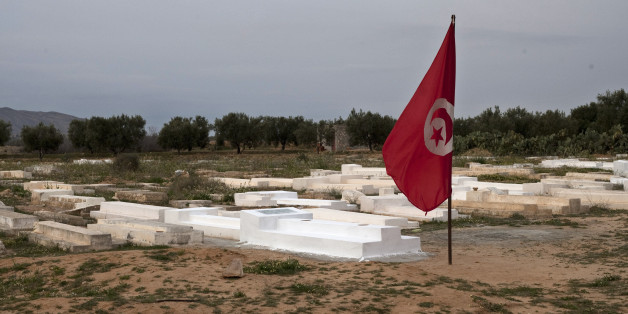 A Tunisian flag flies next to the grave of Mohamed Bouazizi, the local fruit vendor who set himself on fire Dec. 17, on the outskirts of the town of Sidi Bouzid, Tunisia, Wednesday, March 9, 2011. The desperate act set off mass protests that brought down Tunisian President Zine El Abidine Ben Ali in less than a month and inspired others who toppled autocratic Egyptian President Hosni Mubarak, launched an armed rebellion against Libyan despot Moammar Gadhafi, and rattled governments in Yemen, Bahrain and elsewhere. (AP Photo/Giorgos Moutafis)