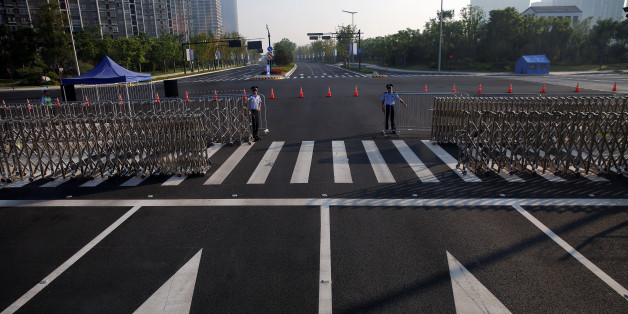 Policemen secure the road near the venue of the G20 Summit in Hangzhou, Zhejiang province, China September 3, 2016.    REUTERS/Damir Sagolj