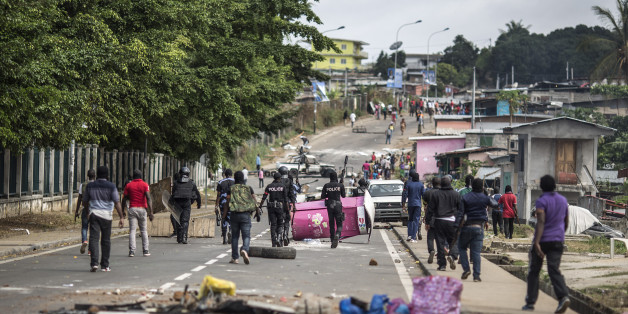 Gabonese police forces are seen clearing barricades in the streets adjacent to the National Assembly  in Libreville on September 1, 2016.
