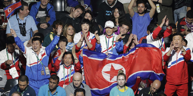 Spectators cheer for Kim Song I, of North Korea, as she plays against Ai Fukuhara, of Japan, during the women's singles table tennis bronze medal match at the 2016 Summer Olympics in Rio de Janeiro, Brazil, Wednesday, Aug. 10, 2016. (AP Photo/David Goldman)