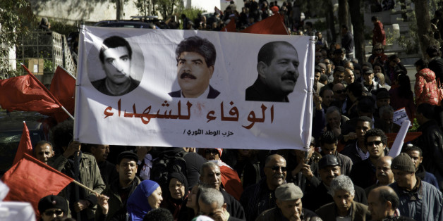 Banner of the Popular Front Martyrs Left Fadhel Sassi center Mohamed Brahmi and left Chokri Belaid. On the occasion of the commemoration of the first anniversary of the assassination of Chokri Belaid, thousands of people gathered at his grave at Al Jalez cemetery in Tunis Tunisia February 8th 2014. (Photo by Mohamed Krit/NurPhoto) (Photo by NurPhoto/Corbis via Getty Images)