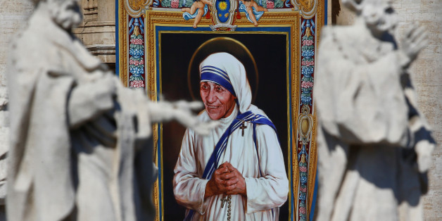 A tapestry depicting Mother Teresa of Calcutta is seen in the facade of Saint Peter's Basilica during a mass, celebrated by Pope Francis, for her canonisation in Saint Peter's Square at the Vatican September 4, 2016. REUTERS/Stefano Rellandini