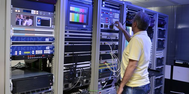 A technician works at the master control room of the private braodcaster Antenna in Athens northern suburb on September 2, 2016. Greece raised 246 million euros ($274 million) on September 2, 2016 by auctioning four private TV licenses in a marathon bid dominated by shipowners including the boss of the country's top football club. Skai and Antenna, also owned by shipowning families, are the sole surviving members of the previous Greek TV cast. The government has said stations that broadcast nati